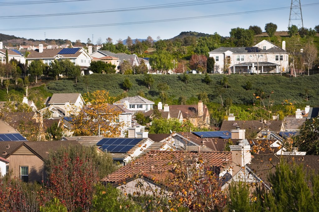 Rooftop view of community with solar panels : Stock Photo