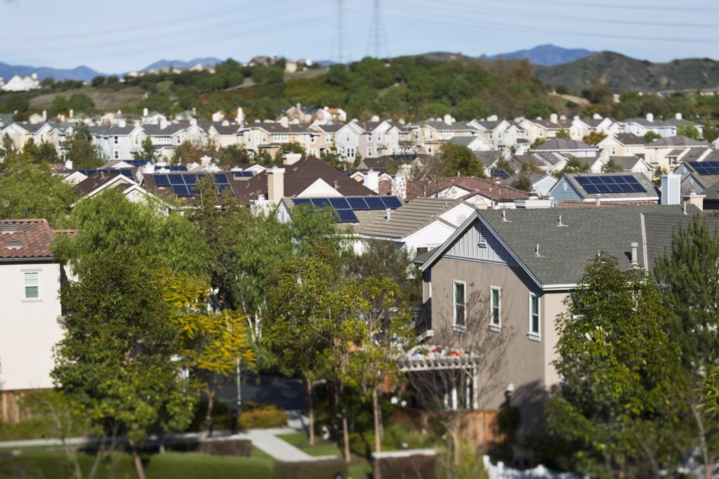 Stock Photo: 4053-9724 Rooftop view of community with solar panels