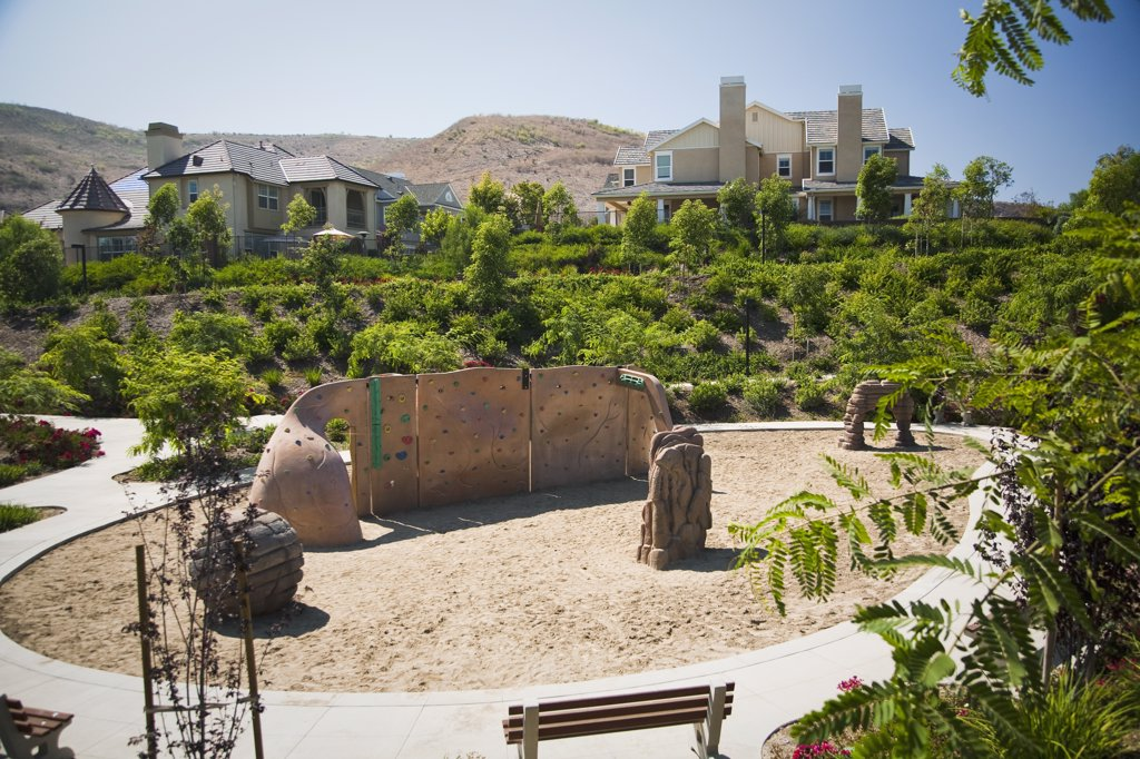 Neighborhood playground with rock wall : Stock Photo