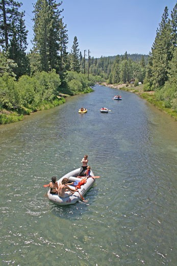 People rafting Truckee River near Lake Tahoe California : Stock Photo