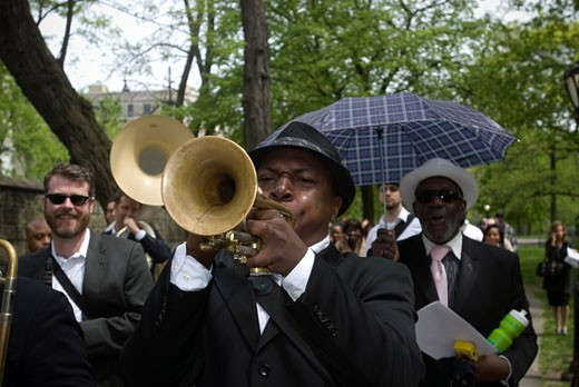 The Duke Ellington Brass Band leaves from the Duke Ellington Memorial on 110th Street and marches through Central Park in a second line procession to celebrate the composer's 110th birthday on Wednesday, April 29, 2009. Edward Kennedy 'Duke' Ellington is considered to be one of the most influential figures in 20th century music and the Duke Ellington Center for the Arts, formed by Mercedes Ellington, is planning a '110 Years Duke!'  festival. ( Richard B. Levine) : Stock Photo