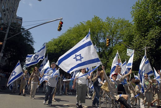 Marchers carry Israeli flags in the Salute to Israel Parade in New York on Sunday, May 31, 2009. Thousands of marches and spectators participated in the huge event which marched up Fifth Avenue. ( Richard B. Levine) : Stock Photo