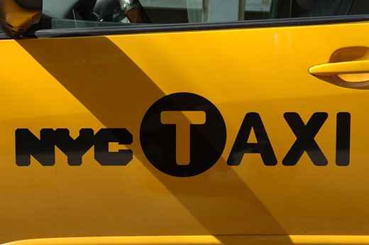 A new NYC taxi logo on the side of a cab. (© Frances M. Roberts) : Stock Photo