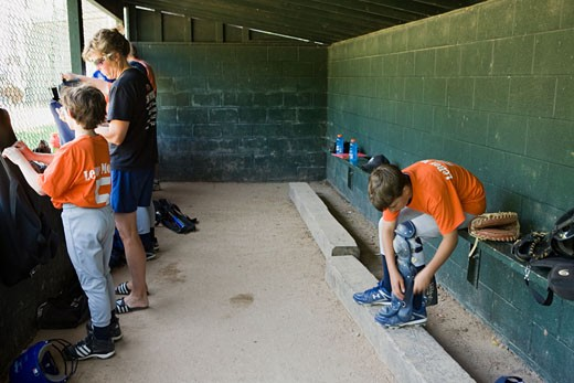 In the dugout at youth league baseball game LeRoy New York Genesee County : Stock Photo