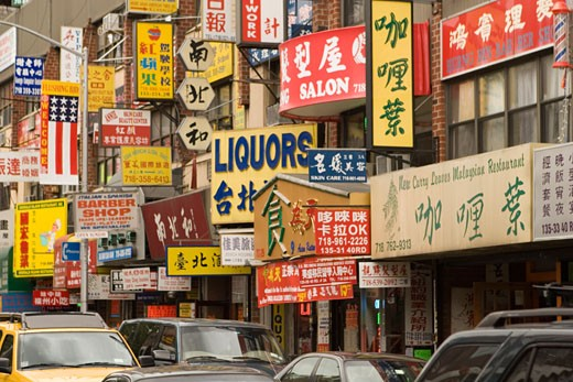 Various signage in multiple languages  Chinatown Flushing Queens NYC NY : Stock Photo