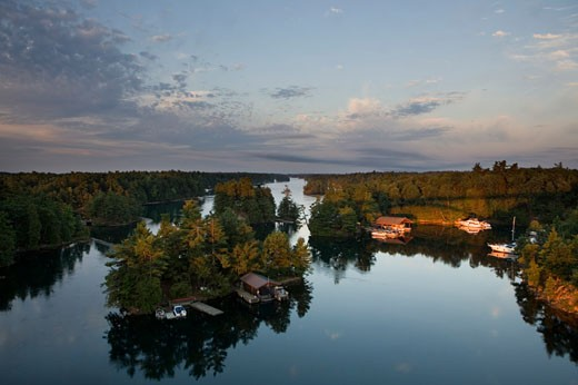 Sunrise St. Lawrence River aka Saint Lawrence Seaway, Thousand Islands, from International Bridge New York to Ontario : Stock Photo