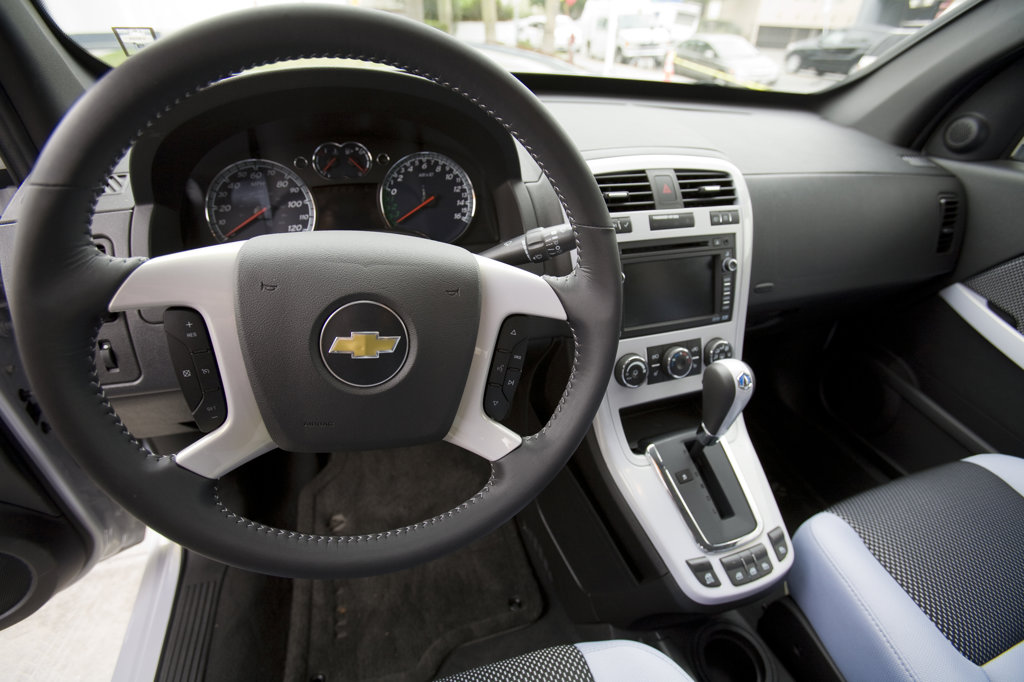 Interior of GM's Equinox SUV. On June 26, 2008, Shell opened California's first retail hydrogen car refueling station in West Los Angeles. In hydrogen vehicles, an electric motor powers the wheels. A chemical reaction inside a unit called a fuel  cell – usually between hydrogen and oxygen – creates electricity for the motor. Los Angeles, California, USA : Stock Photo