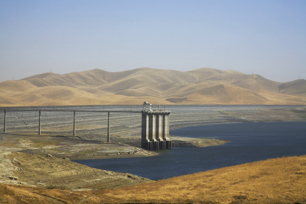 "Stock Photo: 4055-4979 The San Luis Dam and San Luis Reservoir is a water-storage """"off-stream"""" reservoir and is typically low in late summer due to its heavy usage for irrigation, Merced County, California, USA"