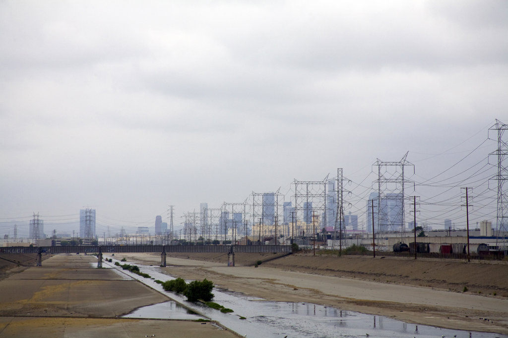 Los Angeles River and Los Angeles skyine in Background. Maywood, Los Angeles, California, USA : Stock Photo