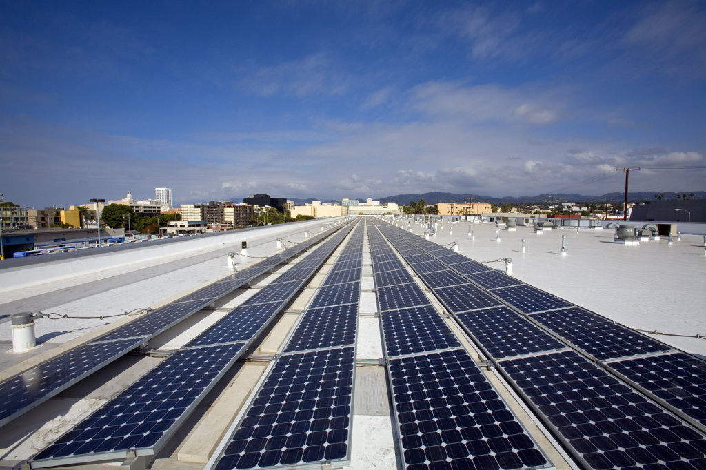 82 Kilowatt Solar Array on roof of Big Blue Bus Terminal, Installation by Martifer Solar USA, Santa Monica, California, USA : Stock Photo