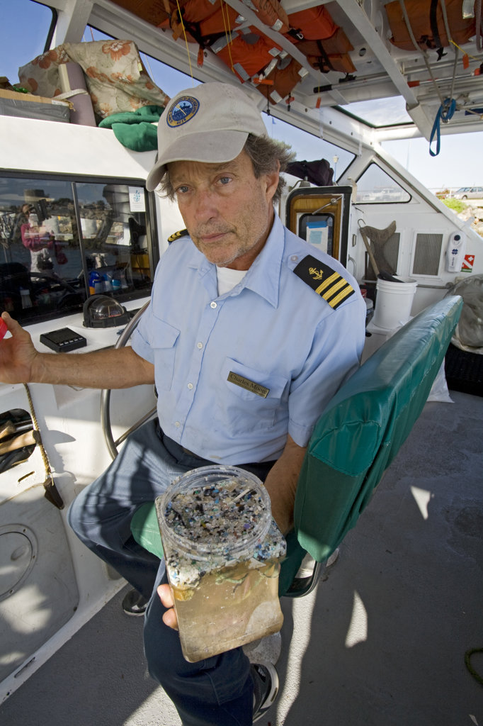 Captain Charles Moore, the man credited for first discovering the plastic soup in the Gyre over 10 years ago, showing plastic samples collected in the North Pacific Gyre. : Stock Photo