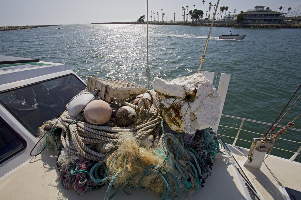 "Trash and assorted garbage collected form the North Pacific Gyre. The ORV Alguita returns to Long beach after four months at sea sampling the waters of the ""great Pacific garbage patch"""" in the North Pacific Subtropical  Gyre (NPSG). The Algalita Marine Research Foundation has been studying and educating the public about the effects of oceanic micro-plastic pollution on the ocean's ecosystem and marine life for over ten years. Long Beach, California, USA. : Stock Photo"