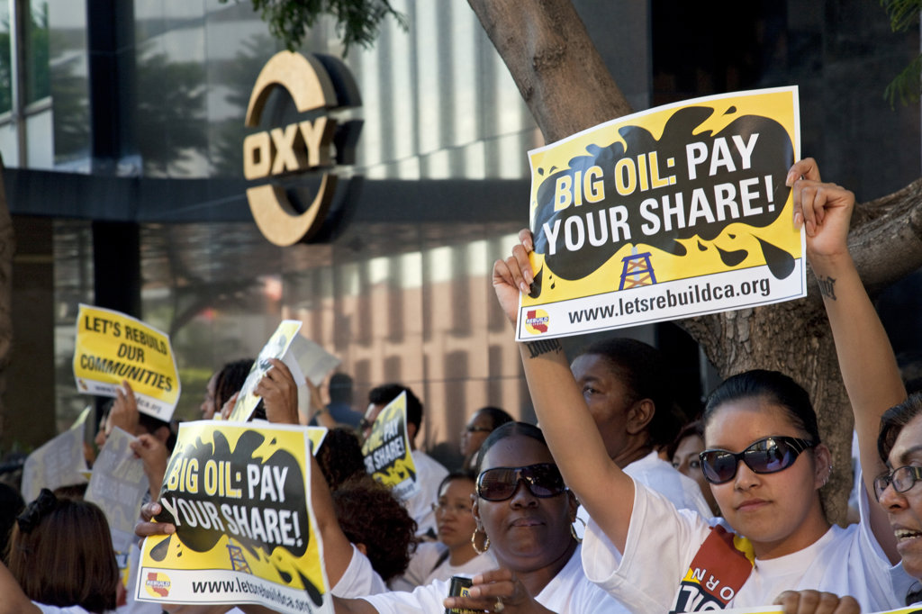 On July 22, 2010, over a thousand protesters marched to Occidental Petroleum offices in Westwood, Los Angeles to demonstrate against the California state loophole that allows oil companies to extract oil, tax free. : Stock Photo
