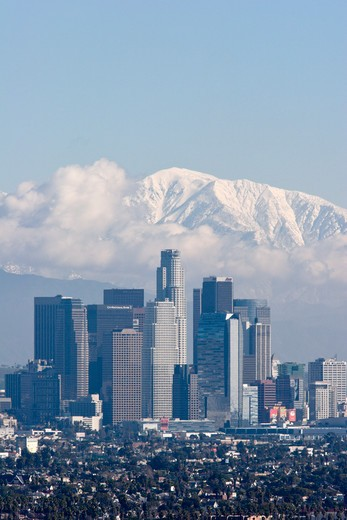 Los Angeles Skyline with Snowy Mount Baldy in Background, California : Stock Photo