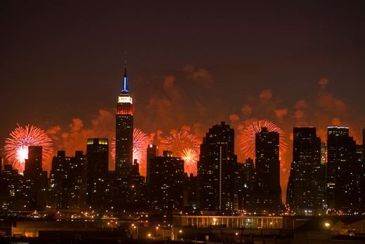 The Manhattan skyline is backlit from the Brooklyn/Queens border on Sunday, July 4, 2010 from the 34th annual Macy's Fourth of July fireworks display in the Hudson River behind it.   (© Richard B. Levine) : Stock Photo