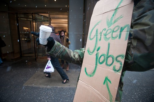 Members of the National Jobs For All Coalition, the National Organization of Women and their supporters protest in front of New York Senator Charles Schumer's office in New York on Friday, January 7, 2011 to call for the creation of jobs by the government and the extension of unemployment benefits. : Stock Photo