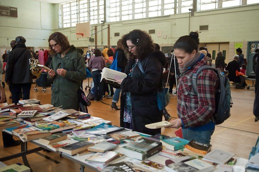 """Thrifty shoppers at a free Stop 'N"""""""" Swap event in the Fort Greene neighborhood of Brooklyn on Saturday, February 26, 2011. : Stock Photo"""