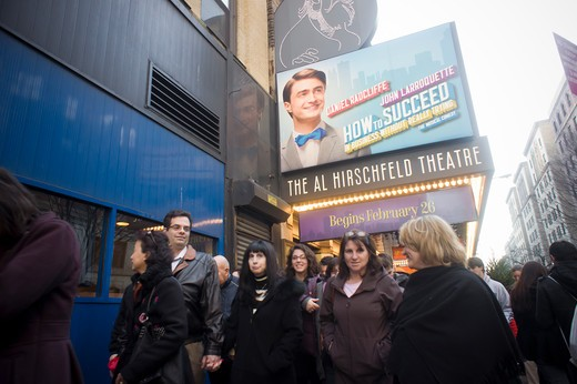 """Theater lovers leave the Al Hirschfeld Theatre after a matinee preview performance of """"""""How To Succeed in Business Without Really Trying"""""""", starring Daniel Radcliffe, on Saturday, March 12, 2011. (© Richard B. Levine) : Stock Photo"""