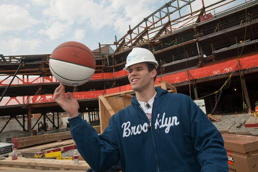 Nets basketball player Kris Humphries speaks to the media about the construction of the Barclays Center in Brooklyn in New York Monday, April 4, 2011. The new stadium for the Nets basketball team is scheduled to open in September 2012 and was the subject of considerable controversy because of the use of eminent domain to obtain some of the land the venue is built upon. (© Richard B. Levine) : Stock Photo