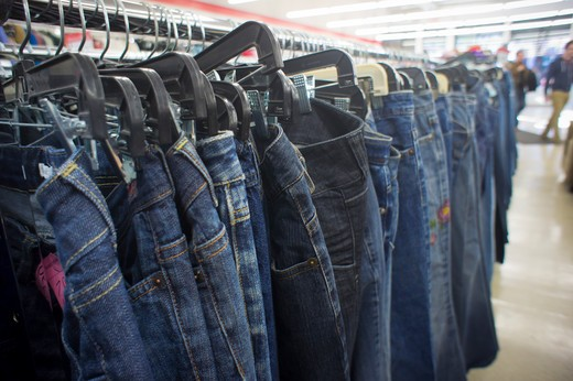 Denim jeans for sale in a thrift store in New York, seen on Saturday, April 30, 2011. Because of the worldwide economic recovery leading to a rise in raw materials and labor costs the prices of clothing is expected to rise 10 percent this year. The cost of cotton has already doubled in the last year. (© Richard B. Levine) : Stock Photo