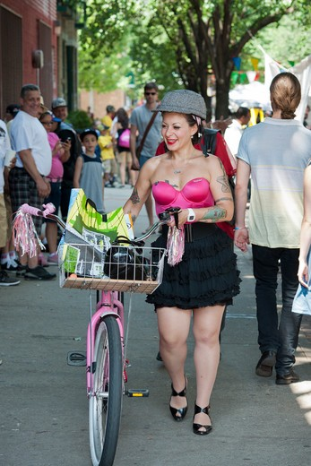 Bicyclists gather in Williamsburg in Brooklyn in New York on Saturday, May 28, 2011 for the Seventh Annual Bicycle Fetish Day. Bike enthusiasts showed off their customized, expensive or old school bicycles to other bike lovers while they competed for prizes and purchased  goods from vendors catering to them. (© Richard B. Levine) : Stock Photo