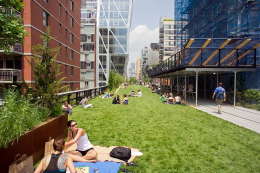 "Visitors enjoy the Great Lawn area of the second phase, from West 20th Street to West 30th Street, of the High Line Park in Chelsea seen on Friday, June 10, 2011. The new section includes a lawn for visitors to sit and sunbathe as well as a """"flyover"""" walkway that raises you eight feet above the foliage. : Stock Photo"