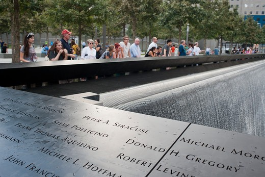 Visitors to the National 9/11 Memorial Plaza in the World Trade Center site in New York Wednesday, September 14, 2011. The memorial consists of twin memorial pools on the footprints of the World Trade Center and a plaza planted with more than 400 swamp white oak trees. : Stock Photo