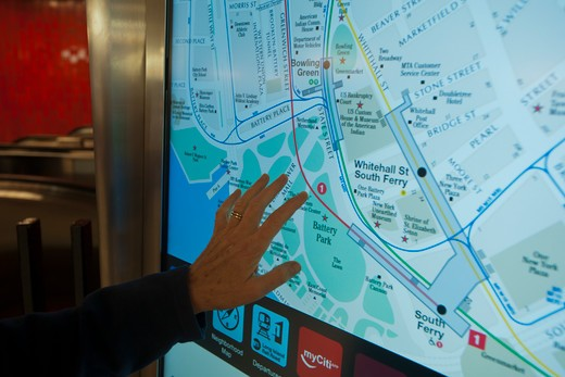 "A commuter uses the newly installed """"On The Go! Travel Station"""" in the Bowling Green subway station in New York on Monday, September 19, 2011. : Stock Photo"