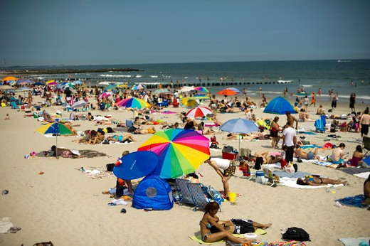 Beachgoers take advantage of the warm summer sun at Rockaway Beach in the Queens borough of New York on Saturday, July 2, 2011 during the Fourth of July weekend.  (© Frances M. Roberts) : Stock Photo