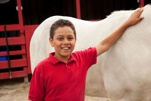 Teenage boy with a horse, Orlando, Florida, USA : Stock Photo