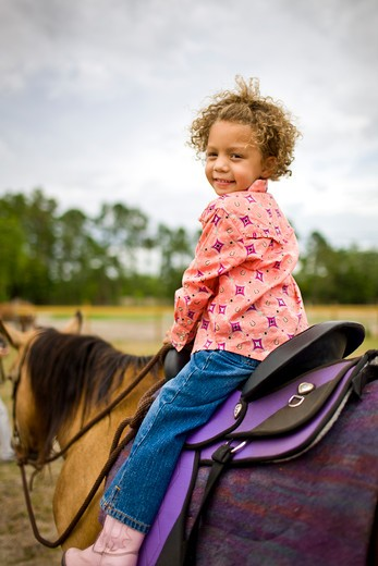 Stock Photo: 4061-170A Girl riding a horse