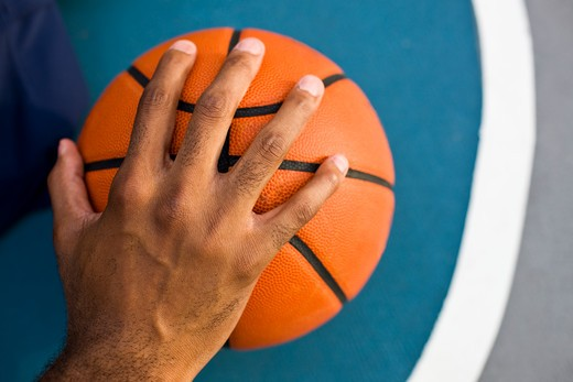 Close-up of a man's hand on a basketball : Stock Photo