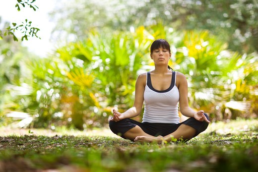 Stock Photo: 4061R-248B Young woman practicing yoga in a park
