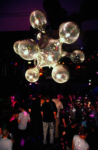 A dancefloor with a futuristic mirror ball; 2000's : Stock Photo