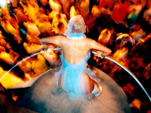Stock Photo: 4062-1163 A Dancer on her podium looking down at the crowd Ibiza 1999