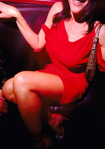 Woman in red dress with Fendi handbag at Club 144 London May 2002 : Stock Photo