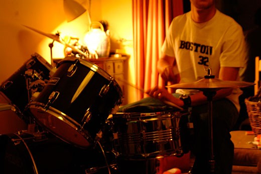 Playing the drums at home; UK; 2000's : Stock Photo