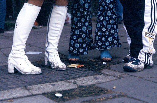 Close-up of some post clubbing feet and shoes at 7am; London; UK; 2000's : Stock Photo