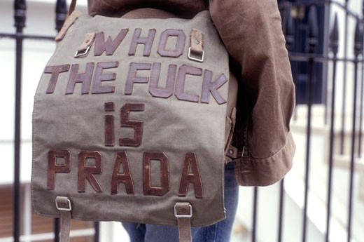Stock Photo: 4062-1765 London Fashion Week sighting: close up detail of a bag with a 'WHO THE FUCK IS PRADA' caption; UK 2003.