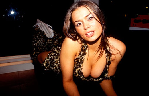 A sexy girl; club dancer; dressed in a leopard skin outfit; showing cleavage; UK 2004 : Stock Photo