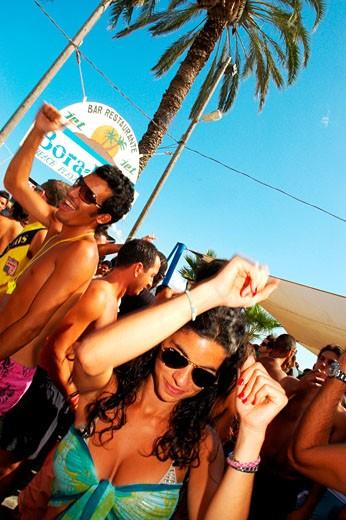 Stock Photo: 4062-2075 Clubbers dancing at Bora Bora beach party, Playa D'en Bossa, Ibiza, 2005