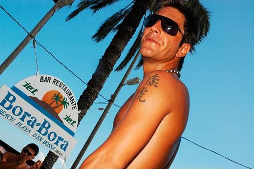 A suntanned man at Bora Bora beach party, Playa D'en Bossa, Ibiza, 2005 : Stock Photo