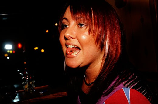Portrait of a girl with a tongue piercing; UK 2005 : Stock Photo