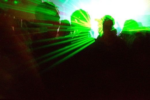 Silhouette of clubbers and lights; UK 2004 : Stock Photo