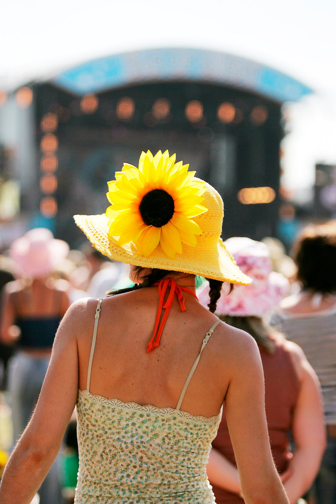 Stock Photo: 4062-2404 The back of a woman wearing a flower in her hat; Nokia Isle of Wight Festival; Sealclose Park; Newport; UK June 2006