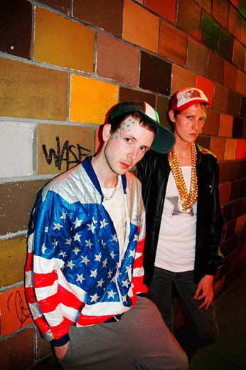 2 young Nu Ravers; wearing Adidas tracksuits; baseball caps and gold chains; Fanklub; Antwerp; Belgium; 2006 : Stock Photo