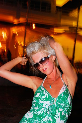 A portrait of a sexy young girl; dancing to music on the beach at sunset; Ibiza; 2006 : Stock Photo