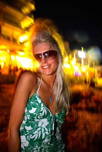 Stock Photo: 4062-2641 A portrait of a sexy young girl; dancing to music on the beach at sunset; Ibiza; 2006
