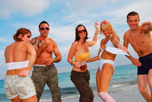 Stock Photo: 4062-2768 A group of young friends dancing on the beach at Bora Bora; Playa D'en Bossa; Ibiza; 2006