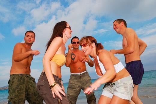 A group of young friends dancing on the beach at Bora Bora; Playa D'en Bossa; Ibiza; 2006 : Stock Photo